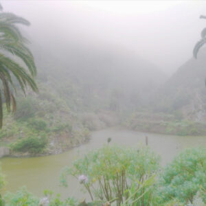 La Gomera on a rainy day, as the clouds touch the surface of the water in the mountains